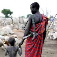 Mandari Cow Herder with Son